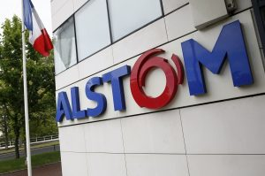 A picture taken on April 27, 2014 in Levallois-Perret, shows the facade of the French engineering group Alstom's headquarters. German industrial giant Siemens said today it wanted to discuss strategic opportunities with France's Alstom, raising the prospect of a takeover tussle with General Electric for the beleaguered firm. The offer came on the heels of reports that the US giant wants to buy the French engineering group, which manufactures the country's groundbreaking high-speed TGV trains.       AFP PHOTO / PATRICK KOVARIK