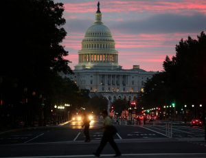 WASHINGTON, DC - OCTOBER 17: The sun begins to rise behind the U.S. Capitol building on the morning after a bipartisan bill was passed by the House and the Senate to reopened the government and raise the debt limit, on October 17, 2013 in Washington, DC. President Obama signed the bill into law, that will fund the government until January 15, 2014 and allow the government to pay bills until February 7, 2014.   Mark Wilson/Getty Images/AFP