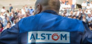 "An unionist takes part in a general meeting against the closure of the French power and transport engineering company Alstom factory in Belfort, eastern France on September 13, 2016.  France's Socialist government was at loggerheads with Alstom on September 13 as Prime Minister Manuel Valls said the train manufacturing giant's plan to close a historic plant, which employs some 400 people, was ""out of the question"". Alstom said the week before that it would be ""impossible"" to continue operations at the site.  / AFP PHOTO / SEBASTIEN BOZON"